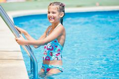 Pretty young girl at pool's edge. Pretty young girl stay at pool's edge Stock Photos
