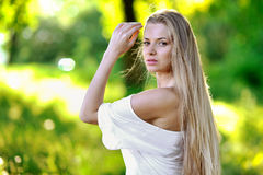 Pretty young girl portrait in sunset Stock Photo