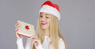 Pretty young girl posing with chrismas present Stock Photos