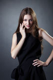 Pretty young girl posing in trendy black dress Stock Image