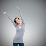 Pretty young girl puts her hands up Stock Image