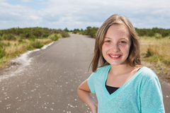 Pretty young girl on a quiet road Royalty Free Stock Photo