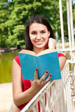Pretty young girl reading book Stock Photo