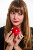 Pretty, young Girl and red apple. Stock Photo