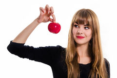 Pretty, young Girl and red apple. Royalty Free Stock Photo