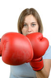A pretty young girl with red boxing gloves Royalty Free Stock Photo