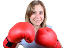 A pretty young girl with red boxing gloves Royalty Free Stock Photos