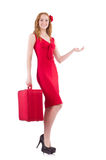 Pretty young girl in red dress holding trunk Royalty Free Stock Photography