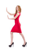 Pretty young girl in red dress isolated on white. The pretty young girl in red dress isolated on white Stock Image