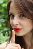 Pretty young girl with red lipstick Stock Images