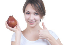 Pretty young girl red pear showing ok Stock Photography
