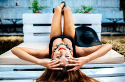 Pretty young girl relaxing outdoor in black swimwear Royalty Free Stock Photography