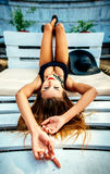 Pretty young girl relaxing outdoor in black swimwear Royalty Free Stock Images
