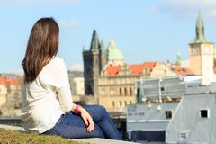 Pretty young girl relaxing / sitting near by river and watching stock photos