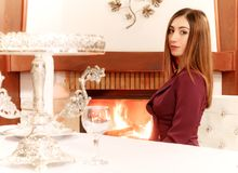 Pretty young girl in the restaurant. Pretty young girl sitting in the restaurant near the fireplace Royalty Free Stock Photo