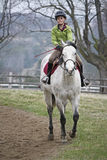 Pretty young girl riding horse Royalty Free Stock Photos