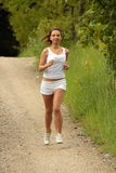 Pretty young girl runner. Royalty Free Stock Photography