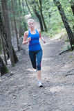 Pretty young girl runner in the forest. Stock Photography