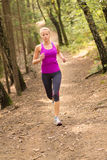 Pretty young girl runner in the forest. Stock Image