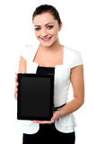 Pretty young girl showcasing a tablet device Stock Photos