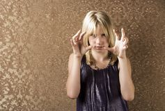 Pretty young girl showing frustration. And making a choking gesture Royalty Free Stock Image