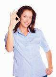 Pretty young girl showing the OK sign over white Stock Images