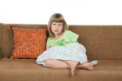 Pretty young girl siting on a sofa Royalty Free Stock Images
