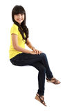 Pretty young girl sitting on something Stock Photos