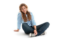 Pretty young girl sitting on white Royalty Free Stock Photography