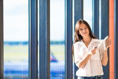 Pretty young girl with small model airplane at the Stock Photos
