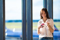 Pretty young girl with small model airplane at the Royalty Free Stock Images