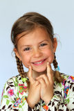 Pretty young girl smiling Royalty Free Stock Photos
