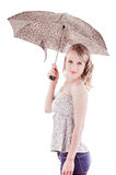 Pretty young girl standing holding umbrella Royalty Free Stock Photo