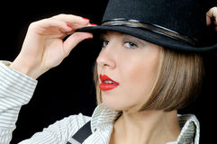 Pretty young girl in stripy shirt and hat Royalty Free Stock Photo