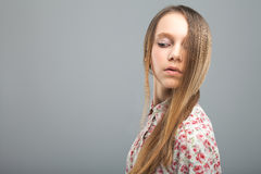 Pretty young girl in studio Stock Image