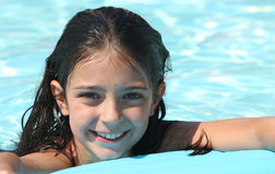 Pretty young girl in a swimming pool Royalty Free Stock Photos
