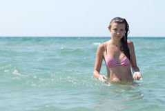 Pretty young girl swimming in a sea Stock Images
