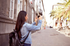 Pretty young girl taking pictures with cell phone Stock Images