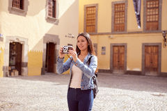 Pretty young girl taking touristy pictures Royalty Free Stock Photo