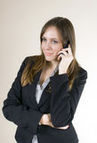 Pretty young girl talking on the phone, smiling Royalty Free Stock Photo