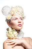 Pretty young girl with tender makeup and flowers on white backgr Royalty Free Stock Images