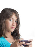 Pretty young girl texting Stock Photography