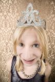 Pretty young girl with a tiara with braces. Portrait of pretty young girl with braces wearing a tiara Royalty Free Stock Image
