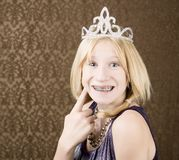 Pretty young girl with a tiara with braces. Portrait of pretty young girl with braces wearing a tiara Stock Images