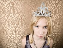 Pretty young girl with a tiara pouting Royalty Free Stock Images