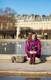 Pretty young girl in the Tuilleries garden in Royalty Free Stock Photography