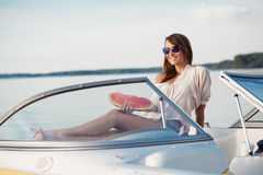 Pretty young girl with watermelon posing on a yacht Stock Photography