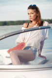 Pretty young girl with watermelon posing on a yacht Royalty Free Stock Images