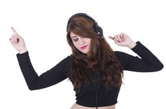 Pretty young girl wearing headphones listening to Stock Photo