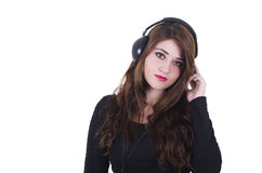 Pretty young girl wearing headphones listening to Royalty Free Stock Image